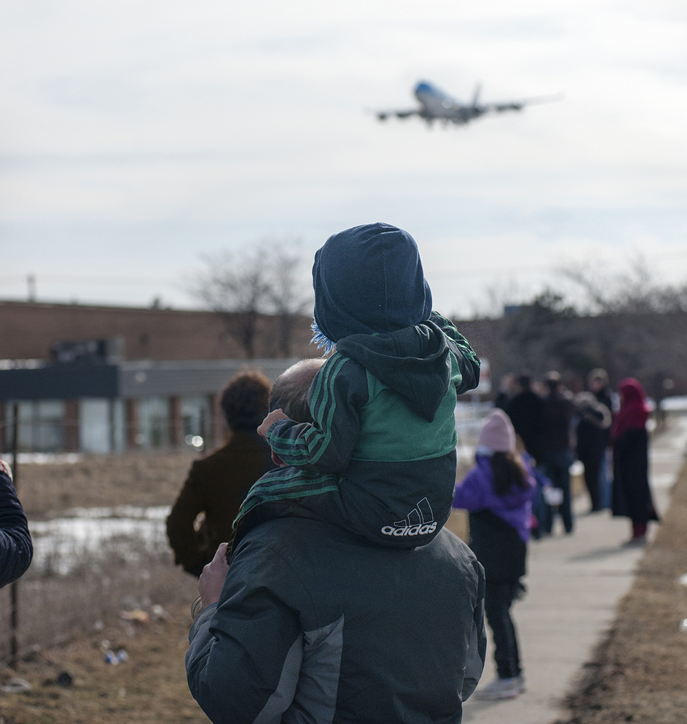 The Laird Co Planespotter on Dad's shoulders KLM 747 arrival Aviation Avgeek Airplane Airline Photography for site.jpg