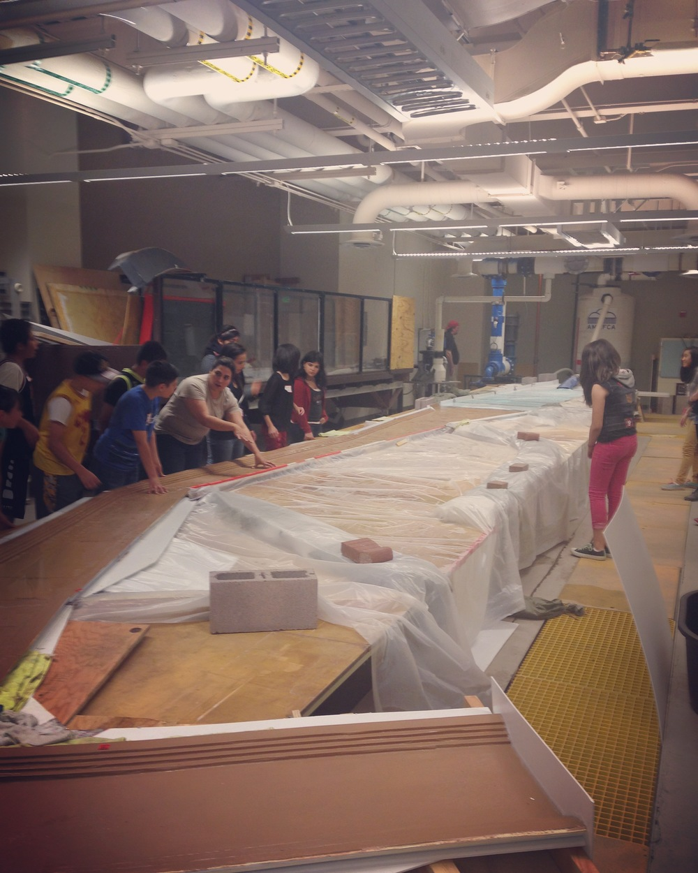 Coronado students manipulate a storm water drainage model at UNM's Department of Civil Engineering