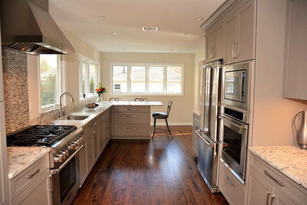 Grey is the New White - I am very grateful to Arthur Zobel for making my kitchen renovation project a huge success! He listened to me and gave excellent suggestions. One suggestion was to rethink my appliances, which I did. I love my new range. Another was solving my storage problems. My kitchen layout is logical and beautiful. The design is well thought out. He gave suggestions on how to stay on budget without compromising the quality of my cabinets and the overall look. He is responsive to phone calls and emails and treats each client by giving his undivided attention. Have Arthur work with you on your next project and you will be very happy!Ellisa K.See full project here