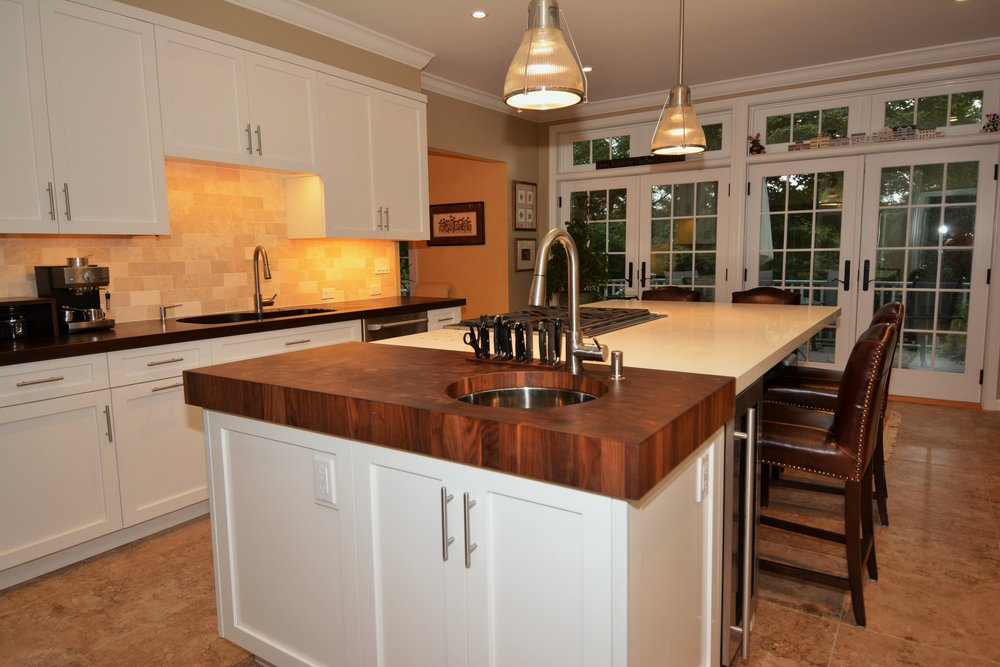 White Contemporary Designed for a Craftsman - I have known and worked with Arthur Zobel for many years.When it came time to design and purchase my own kitchen I naturally went to him.The result exceeded my expectations and left me very satisfied.- Richard B.See full project here