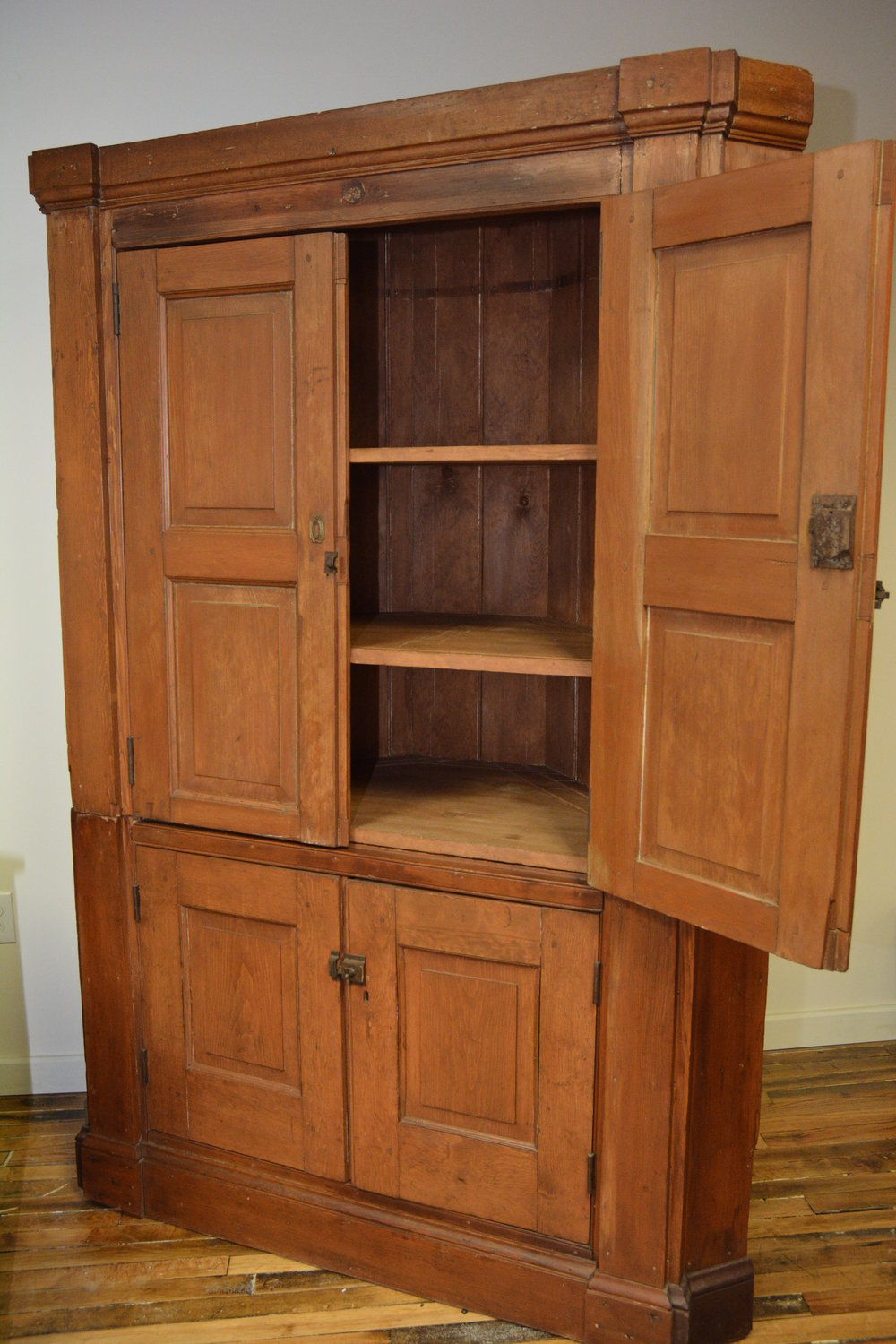 Unusal Corner Hutch - Bring old world character into your kitchen with this antique corner hutch. The shelves have a a double row of grooves for displaying and storing plates and platters, and the hutch boast a full 22