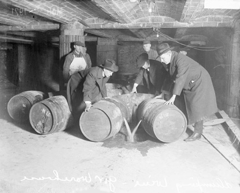 Barrels of alcohol were discovered and destroyed frequently throughout the Prohibition Era, like this photograph from 1921 depicts.