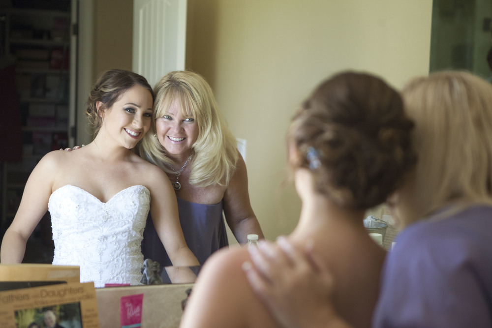 There are few moments that surpass the joy of mom and daughter preparing for the big day.