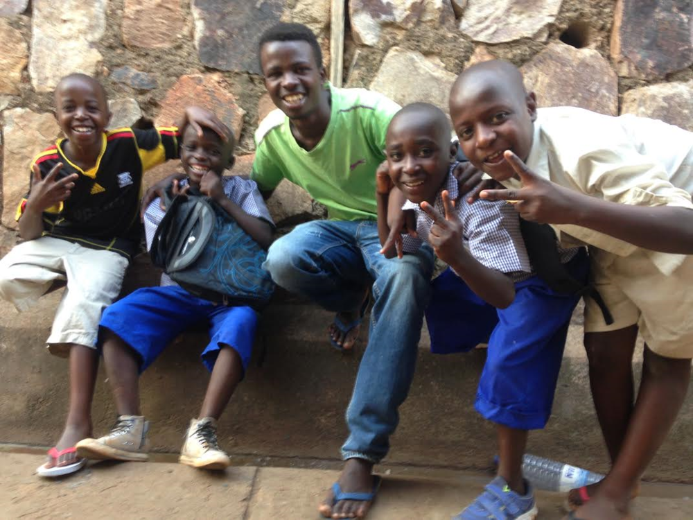 Manzi and Francois had just got back from their first day of school. We all wanted the photo from the excitement. Even Shyaka who helps take care of them needed to be in the photo with them because he was proud.