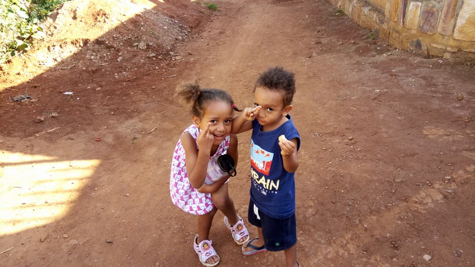 Little Keza and Caleb went for a walk after all of their big brothers came back from their Rafiki Run in Rwanda