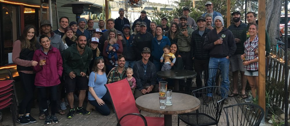 The runners and supporters enjoying their first beverages after running at the Baywood Ale House