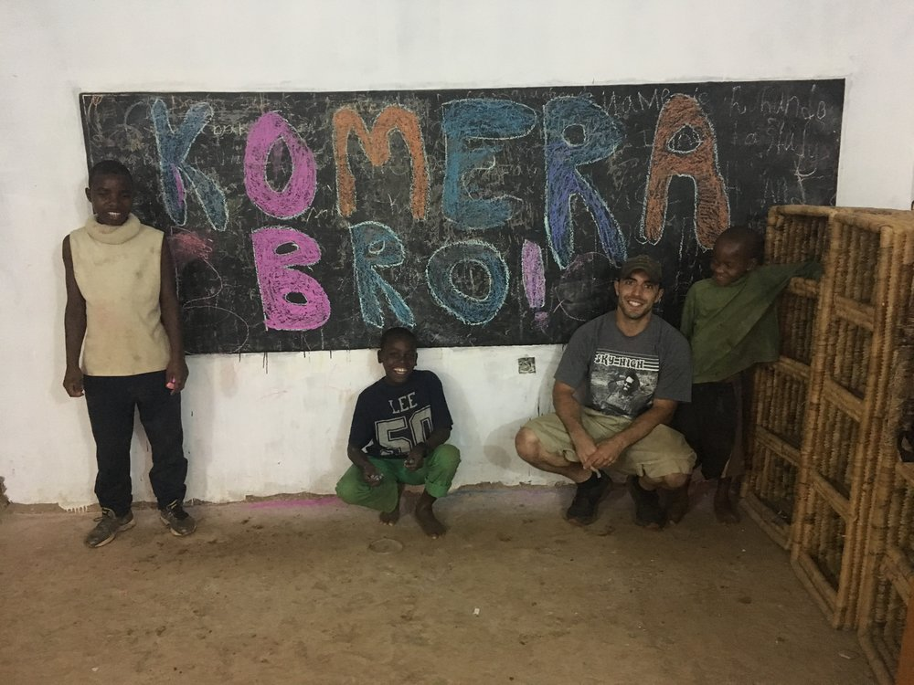 "I always like to use the Kinyarwanda phrase ""komera."" It means ""Be strong."" It is used for anything and always as a way to try to give strength to the receiver. I specifically had the kids do this on the chalkboard so a friend of mine who is undergoing intense chemotherapy would feel the love from Rwanda."