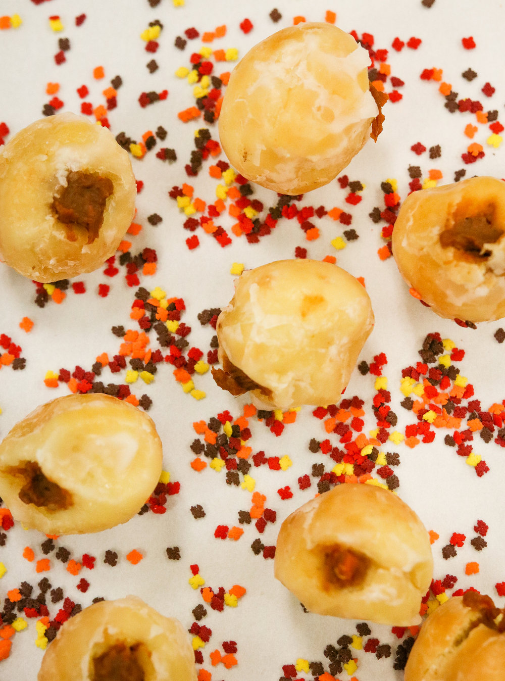 MARSHMALLOW N' YAM HOLES - DONUT HOLES STUFFED WITH YAM AND GLAZED WITH MARSH GLAZE!3/$1.25 // AVAILABLE BY 11AM!