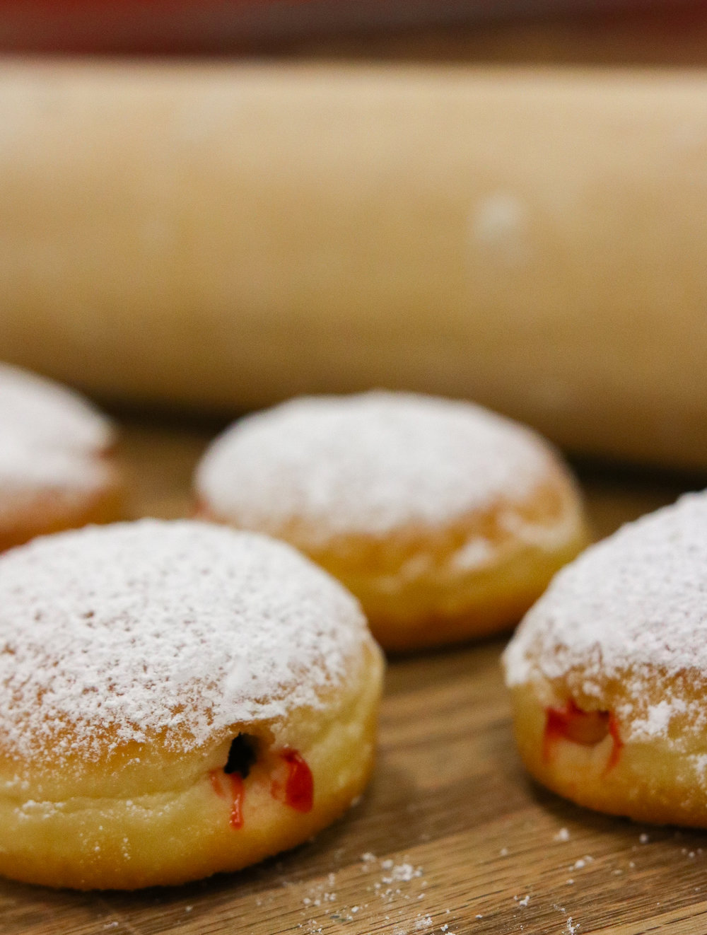 SUFGANIYAH - A TRADITIONAL MINI JEWISH HANNUKAH TREAT. MINIATURE JELLIES FILLED WITH RASPBERRY AND TOPPED WITH POWDERED SUGAR.$2.50 // AVAILABLE AT 11AM