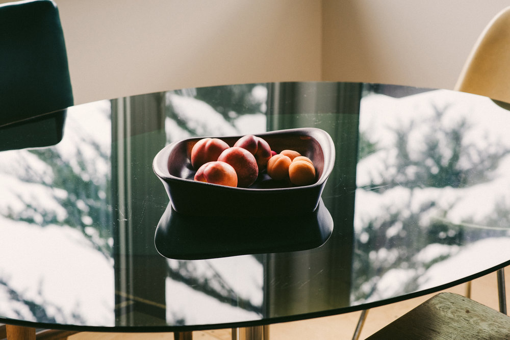 Fruit bowl and tree reflected in Jill's kitchen dining table.