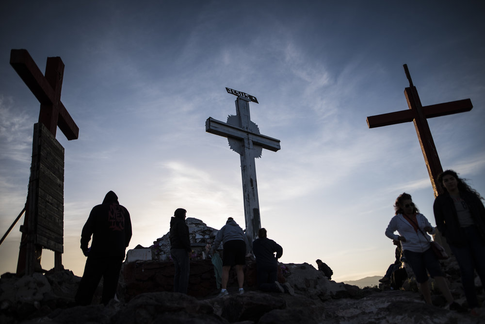 Crowds gather atop Tome Hill as part of a yearly pilgrimage that gathers thousands of people to Tome Hill, New Mexico. New Mexicans climb the hill during Easter weekend to pray and remember lost loved ones.