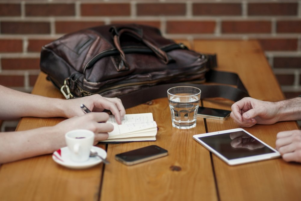 Two people meeting for coffee