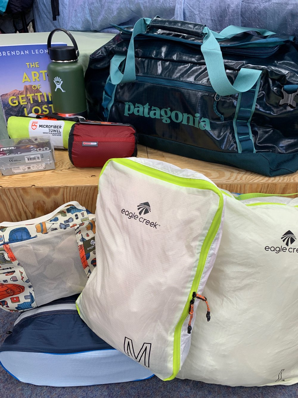 RAFFLE PRIZE #2 - Adventure Travel - Patagonia Black Hole 60L Duffel: $129Eagle Creek Pack-It Sacks: $100Sea to Summit Reactor Liner: $65Hydroflask 32oz. Insulated Bottle: $40Petzl Tikka Headlamp: $30The Art of Getting Lost by Brendan Leonard: $26Gear Aid Camp Towel XL: $25Total Approximate Retail Value: $390