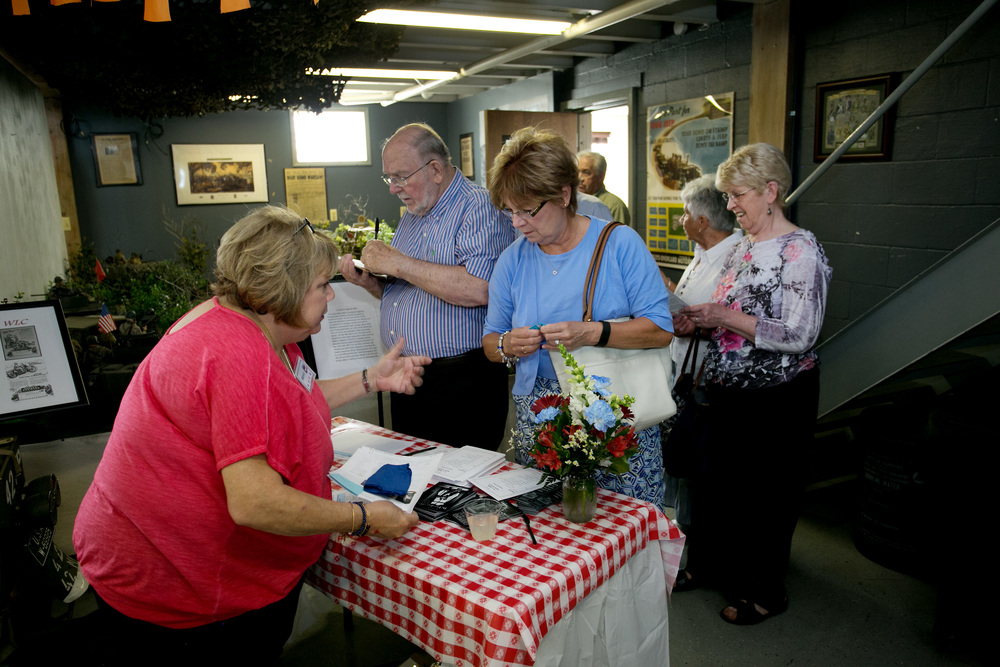 Kowalczyks and Kathy Trimble checking in w Marlene Heitmanis.jpg