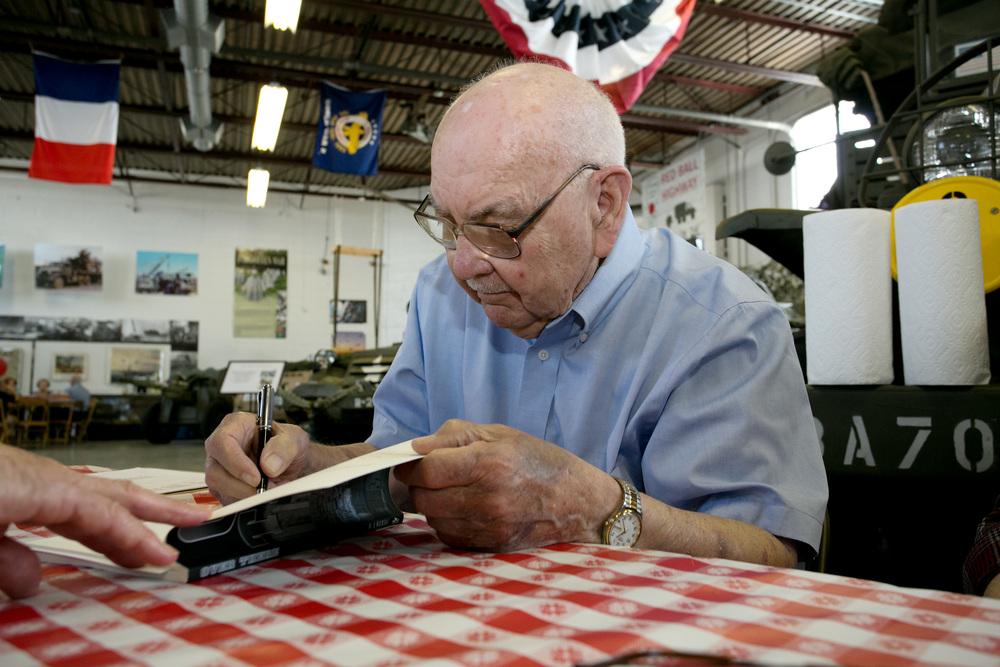 Closeup Bob signing book.jpg