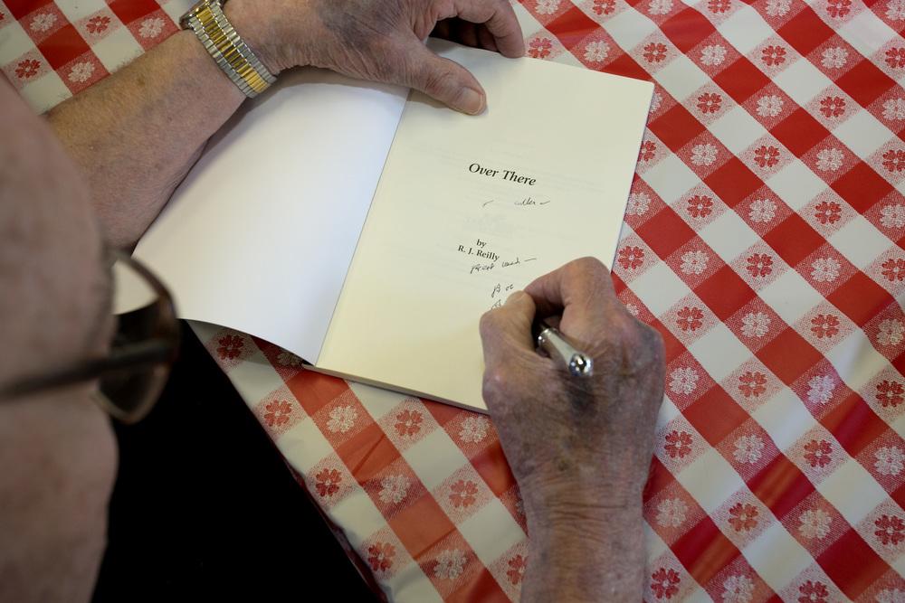 Bob signing a book.jpg