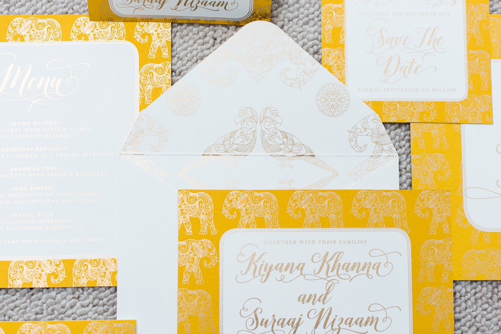 trio-of-life-gold-elephant-envelope-wedding-invitation.jpg