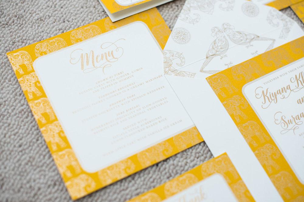 trio-of-life-gold-elephant-menu-wedding-invitation.jpg
