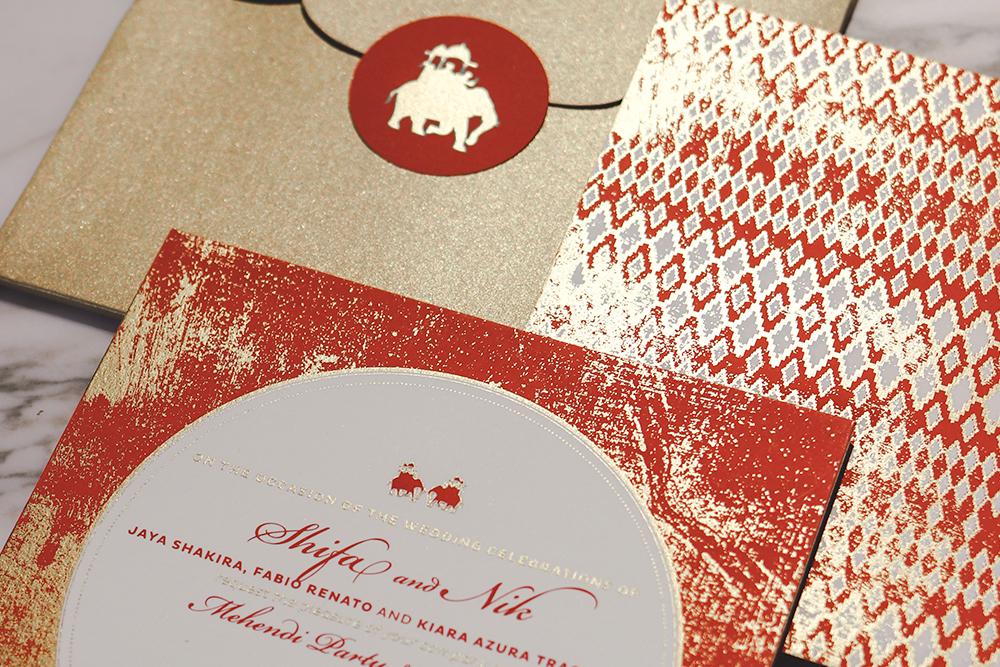 orange-gold-bespoke-indian-weddings-invitation.jpg