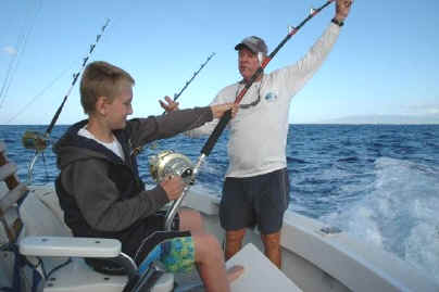 Hawaii fishing charter kid fishing