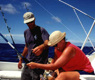 Here, the crew assists with the fishing rod