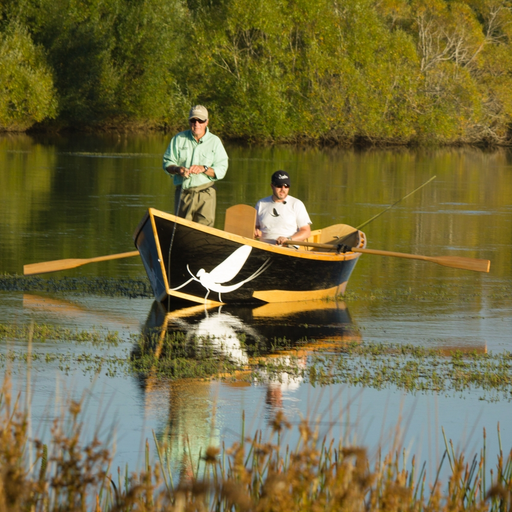 Fly fishing from a drift boat on Brumby's Creek, Tasmania