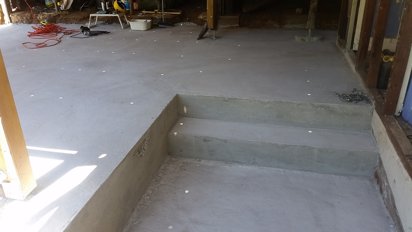 Split level concrete floor and step after removal of formwork.