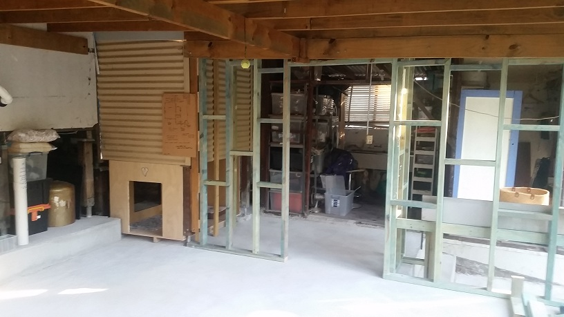 "this! integrated dog kennel, functional split level ""flat"" concrete floor, concrete retainer barrier left of photo, internal stud walls creating separate carport, work area, and the end result ...."