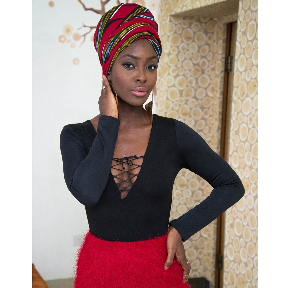 Make up: Buchi Akpati  Photography: Buchi Akpati  Styling:Top(lace-up leotard)-The Keeper Of The Wardrobe  Skirt- The Keeper Of The Wardrobe  Head wrap- Mumsie's collection.