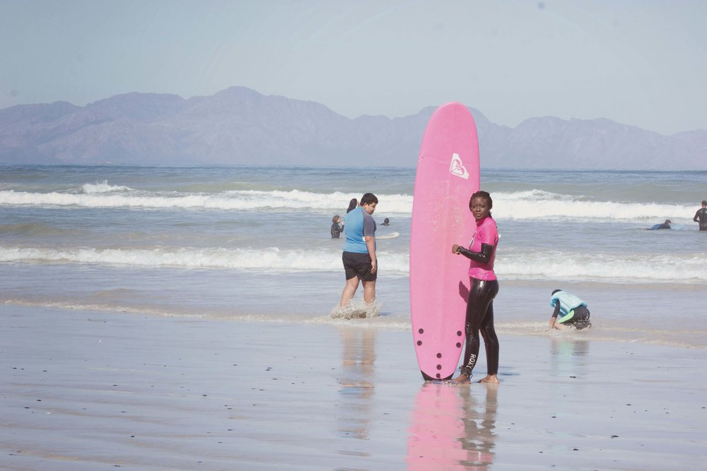 Surfing for the first time thanks to the  Roxy Surf Emporium , Muzienberg Beach, Cape Town. South Africa.