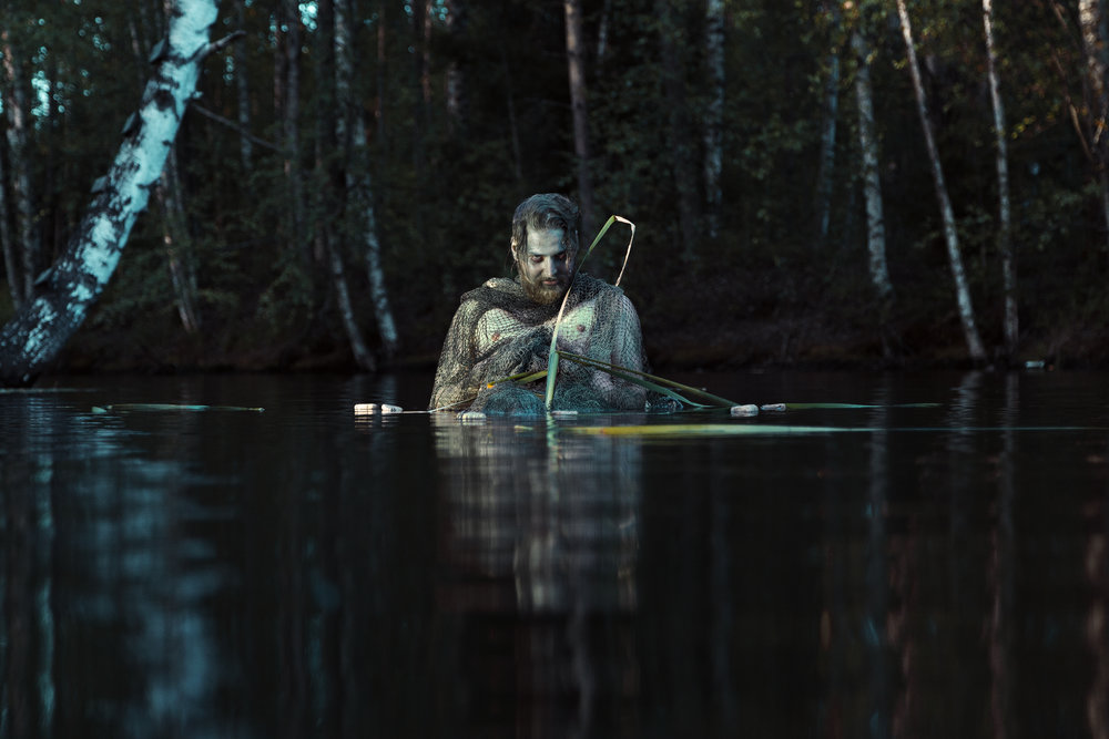Näkki, 2016 or a vesihiisi is a traditional bad spirit that lives in rivers and lakes. It lures unlucky bypassers to get into water, and then pulls them under the surface. It's said that Näkki is a soul of a drowned person, who haunts people to find peace. Parents scare their children with stories of Näkki, so they won't go to the waterfront alone.