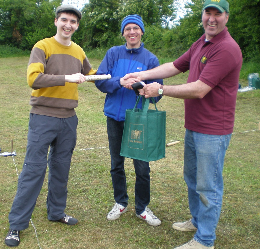 KubbUK 2009 champions - 'Londoners' - holding their personally engraved rolling pin and Kubb set, presented by Jesse Brough from  Crown Darts .
