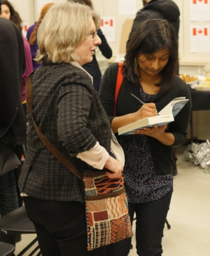 Signing books. Photo by Andrew Sampson, CBC