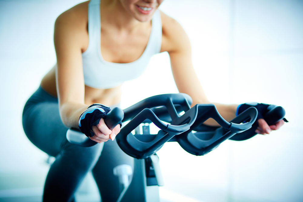 stock-photo-close-up-of-young-female-training-on-simulator-in-gym-146066507_MB.jpg