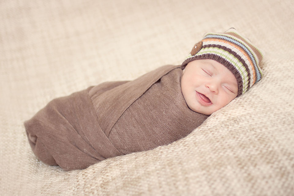 Newborn Sleeping Wrapped Smiling