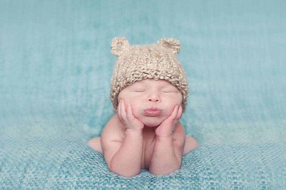 Newborn Head in Hands Bear Hat COMPOSITE IMAGE