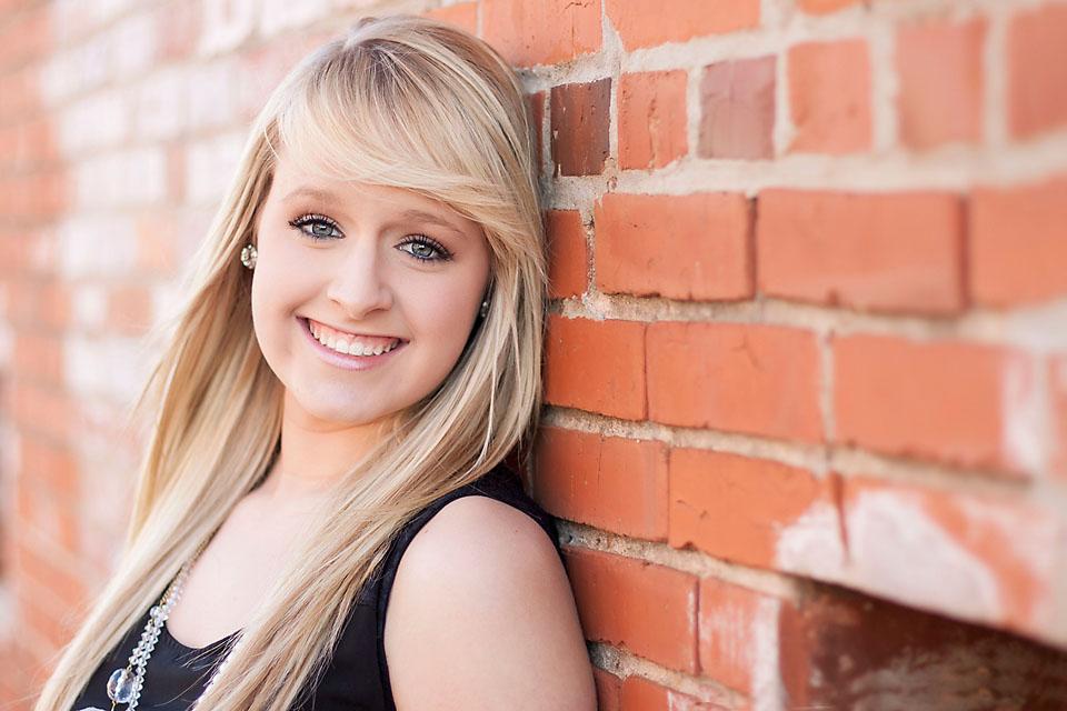 Senior Girl Photo with Brick Wall