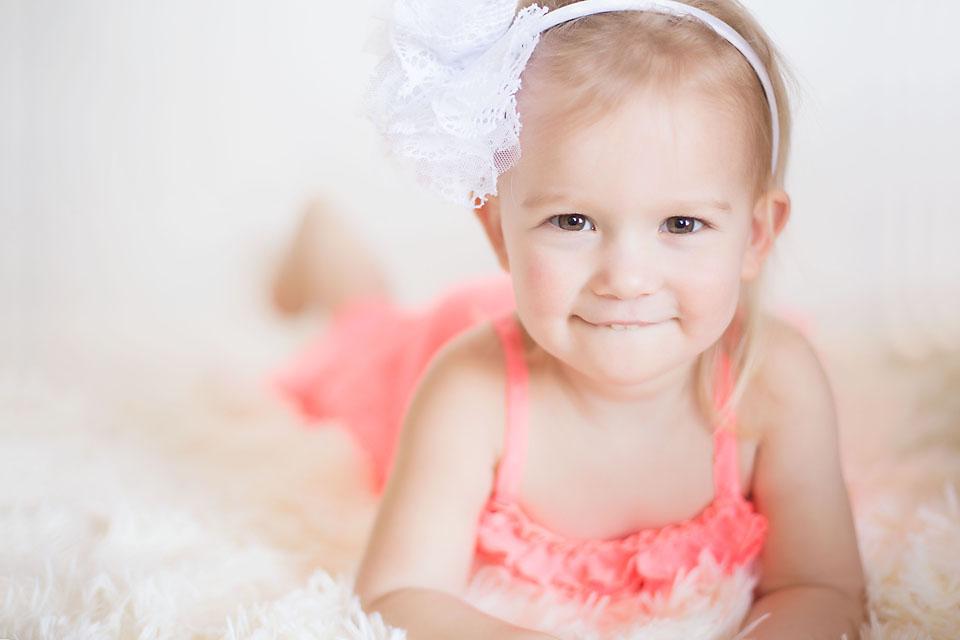 Little Girl Smiling on White Backdrop