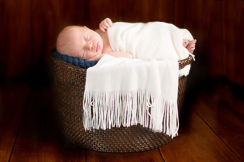 Newborn Baby Boy Wrapped in White in Brown Basket