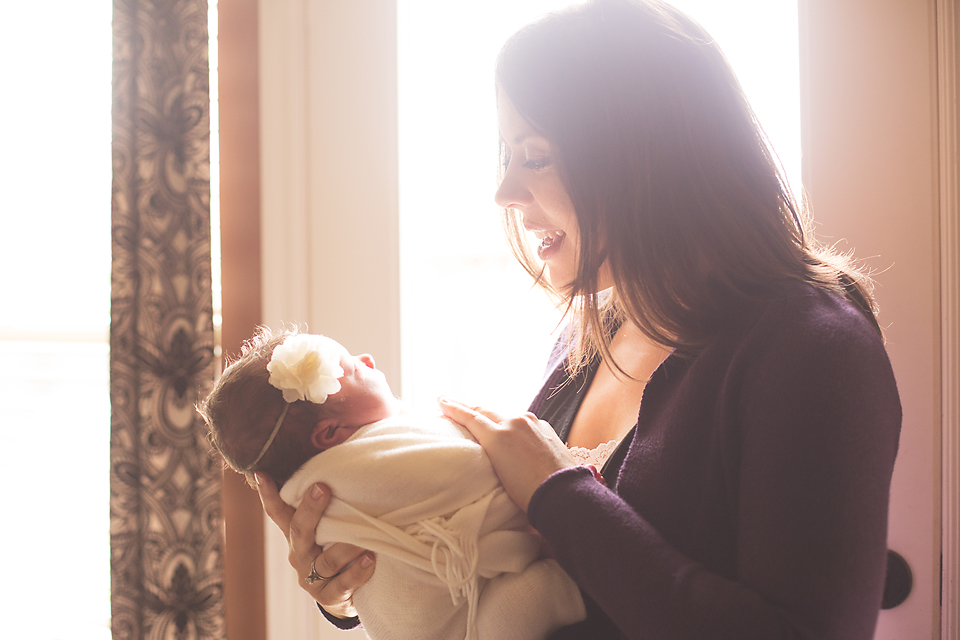 Cute newborn baby girl with mom lifestyle newborn photography