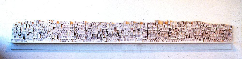 Every Body, 1997,  laser print tranfers on 635 blocks, shelf, dimensions variable. 2' x 16' installed