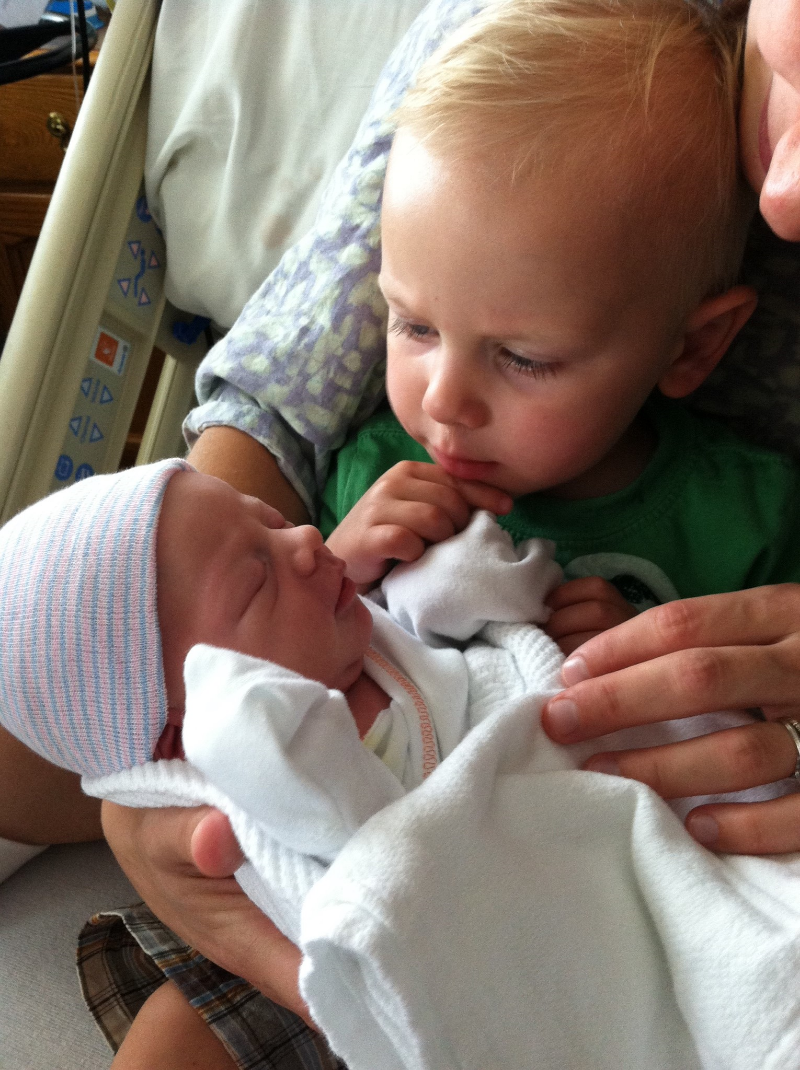 Two year old Elliott meets Theo for the first time. (Photo used with parent's permission)