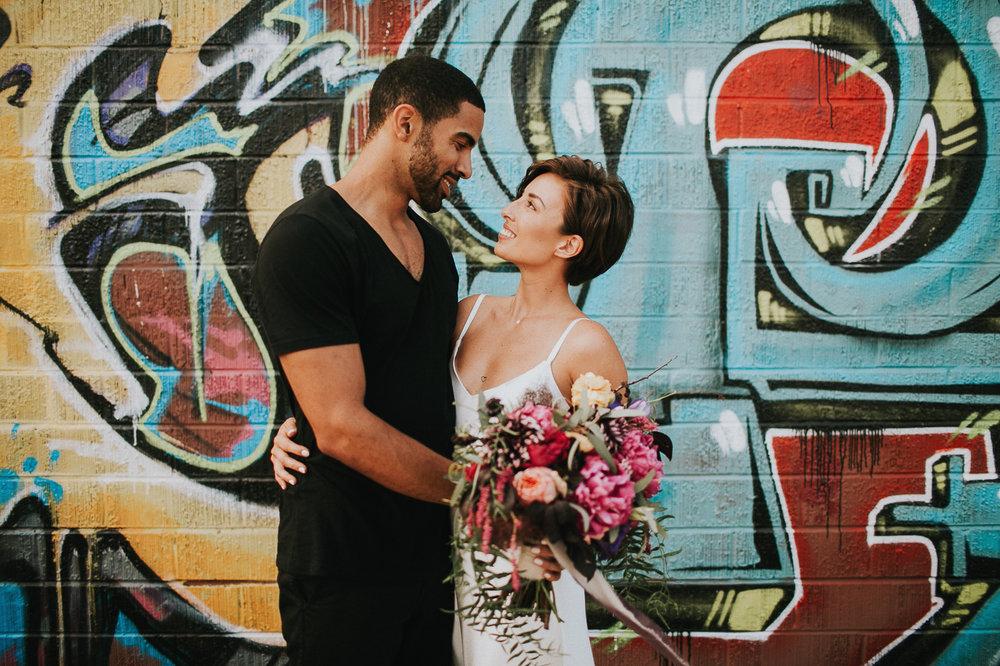 Downtown LA Arts District Wedding Portraits, Hot bride & groom on a graffiti wall. Planning & Design, Art & Soul Events