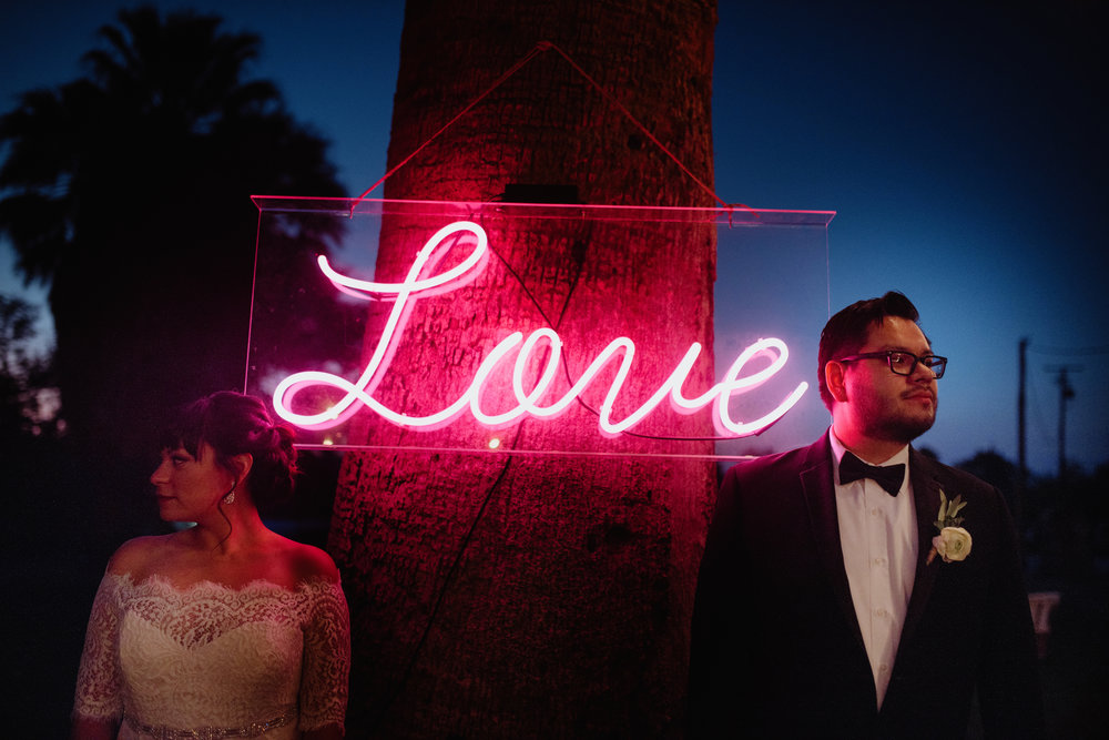 29 Palms Inn Wedding, Bride and Groom Smile, Art & Soul Events, Photographer June Cochran, Neon Love Wedding Sign, Joshua Tree Wedding
