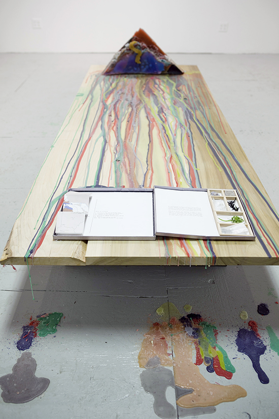 """Platform (including book """"Art in the Earth: A Field Guide from the Soil to the Studio"""" and """"Wax Corner""""), 2012, Poplar, wax, mixed media, 9 x 9 x 3.5 feet"""