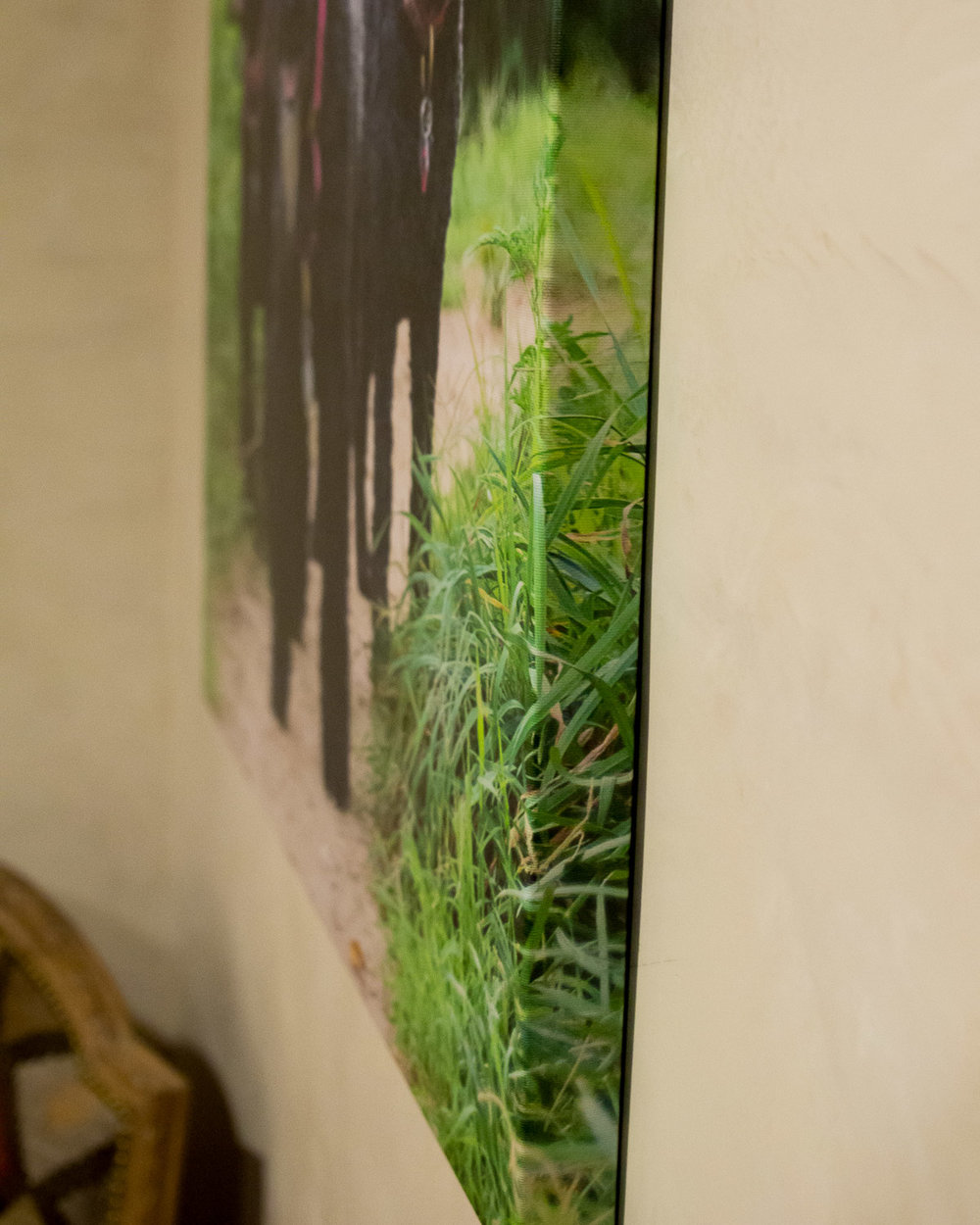 "Our Canvas prints are wrapped around a 1.5"" wooden stretcher frame, and we come and hang all wall art for you."