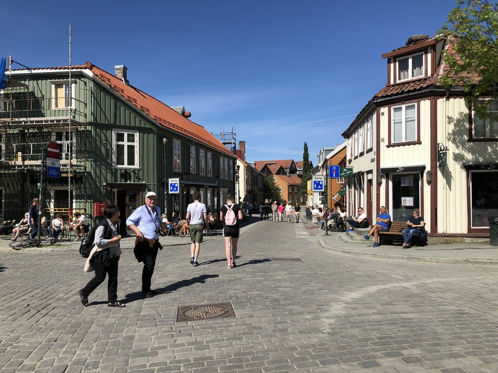 Trondheim, Norway. Streets for walking and gathering, with retail at the street level and housing and offices above, prevent most nuisances from the get-go, but also make people happy and respectful.
