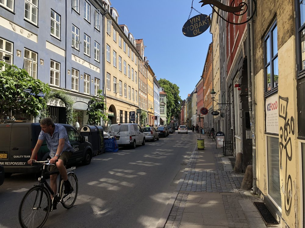 A high density street in Copenhagen, Denmark is quiet, correctly illuminated, and minimizes pollution and noise nuisances of cars.