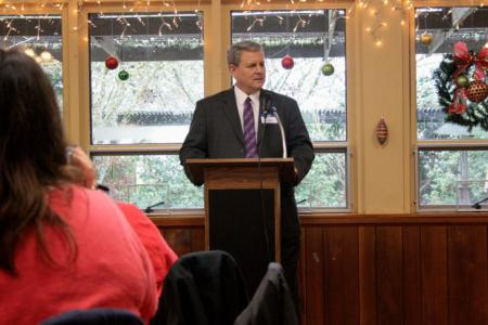 Photo: Sid speaking at the Benton County Republican Women's Christmas Luncheon.