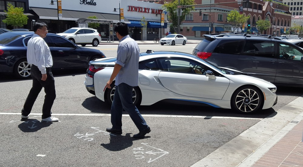 Strangers Walking Around BMW I8 When Parked